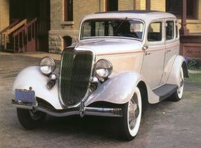 A reshaped grille was among the styling changes for the 1934 Ford DeLuxe Fordor. See more classic car pictures.