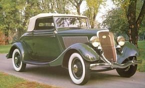 The 1934 Ford DeLuxe Roadster was popular among the police and crooks for its explosive speed. See more classic car pictures.