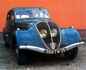 The 1935 Peugeot 402's headlights were put behind the sloping grille shell.