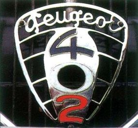 The crank hole cover identified the 1937 Peugeot 402 and flew the colors of the French flag as well.