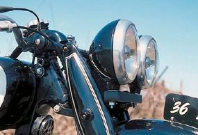 A girder fork was common for the era. Dual lamps weren't.
