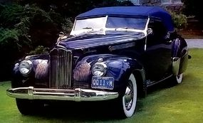 A dark color is perfect for showing off the bright chrome trim of the 1941 Packard Darrin One Eighty Convertible Victoria.