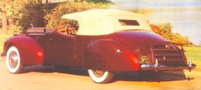 The most easily noticed feature on this 1940 Packard Darrin Convertible Victoria is the Darrin dip in the doors -- the designer's sporty trademark.