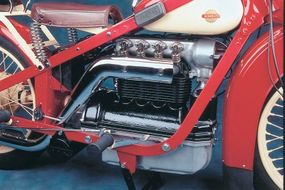 The 45-cubic-inch overhead-valve four used efficient cross-flow design but had exposed valve springs.