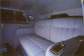 Interior upholstery is broadcloth in the rear.