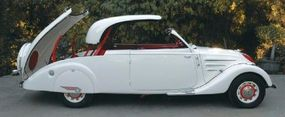 The retractable hardtop of the 1938 Peugeot 402 B stores neatly in the long trunk.