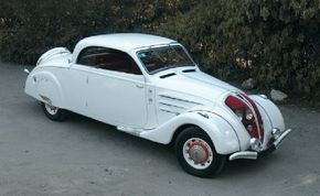 With the top up, the 1938 Peugeot 402 B exudes style and grace. See more classic car pictures.