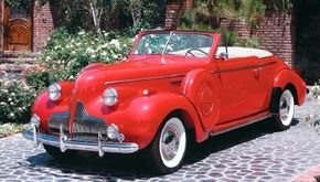 The 1939 Buick Century convertible coupe had an engine underneath its elongated hood. See more pictures of Buicks.