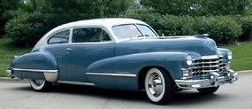 """This 1947 Cadillac Series 62 coupe fastback has """"sombrero"""" wheelcovers, a new design element for that model year."""