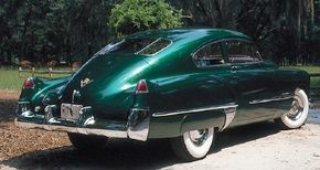 Cadillac's hallmark tailfin design is the crowning glory on this 1948 Cadillac Series 61 coupe fastback.