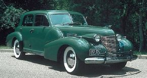 A sliding metal sunroof was a new (though rarely ordered) option for the 1940 Cadillac Sixty Special Sedan. See more pictures of the 1940-1949 Cadillac.