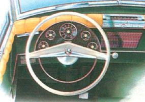 The catalog of Rejected Kaiser-Frazer concept cars includes this proposed instrument layout. Padding on door and dashtop shows an interest in safety.
