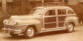 Wraparound grille bars marked the 1942 T&C, here with accessory spotlight and roof rack.