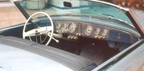 Pushbuttons in the cockpit controlled the top, headlights, windows, and rear deck.