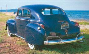 The Town sedan shown here features rear quarter windows.