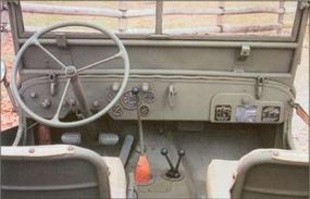 The 1944 Ford GPW Military Jeep's interior belies its utilitarian function.