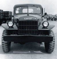 The military influence on the 1946 Dodge Power Wagon can be seen in the hood, grille, fenders, and bumper.