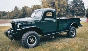 The beds of early pickups like this 1947 Dodge Power Wagon had flat sides with four stake pockets.
