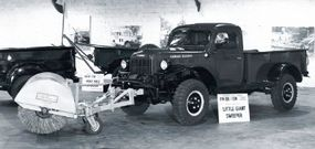 One commercially produced attachment was the street sweeper mounted to the front of this 1948 Dodge Power Wagon.