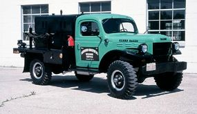 A welding unit sits atop the flatbed fitted to this restored 1952 Dodge Power Wagon cab-and-chassis unit.