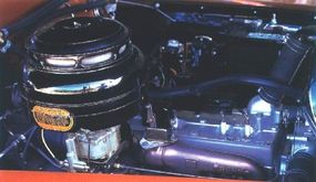 A 323.5-cubic inch straight-eight engine provided the Chrysler Town & Country Hardtop with plenty of power.