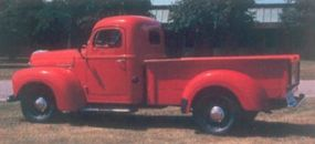 The 1948 International KB-2 pickup shown here sports the optional Knox box, which included a heavy-duty checker-plate grain bed.
