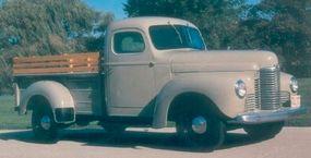 This 1949 International KB-2 pickup wears an International-built pickup box. Horizontal ribs give the sides increased rigidity.