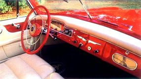 The speedometer marks kilometers, yet the gauges on the dash have an American look.