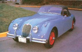 """Last of the XK line was the more """"matronly"""" 150, represented here by a 1958 drophead."""