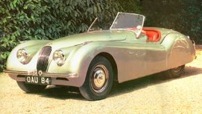 This beautifully restored 1950 XK-120 roadster wears the distinctive rear wheel-well covers and steel wheels that were standard on the normal-tune models.