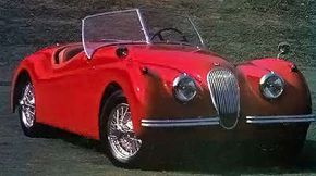 The XK-120 roadster in top-down form was one of several available models.
