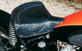 A notch in the fuel tank accommodates the seat.