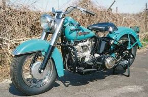 The now-classic bucket headlight and chrome trim were popular accessories offered on the 1949 Harley-Davidson FL Hydra-Glide motorcycle. See more motorcycle pictures.