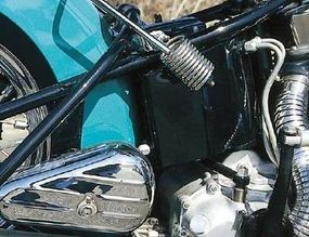 The overload spring could be swung into place to assist the sprung seatpost when a passenger or heavier rider was aboard.