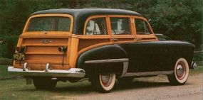 With the tailgate down, the 1949 Oldsmobile 76 station wagon had great cargo capacity.
