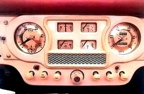 The 1950 Austin A90 Atlantic Convertible's dashboard featured center-mounted gauges that were compatible with left- or right-hand steering.