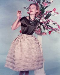 Tea-length skirts, boat-neck blouses and big jewelry will make for one hip chick.
