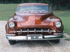 A 1950 Mercury grille opening was fit with a grille fashioned from a 1959 Imperial center bar.