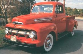"""The 1951 Ford pickup sported a new grille with a """"toothy"""" single-bar design. The look would carry on with minor revisions through 1956. See more classic truck pictures."""