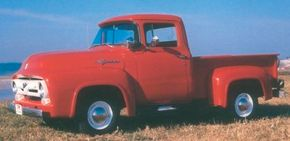 This 1956 Ford F-100 pickup was among the last of the classic rounded-form pickups and a treasure for it. Note the period-trendy wraparound windshield. See more classic truck pictures.