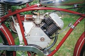 Whizzer's initial 138-cc flathead single-cylinder engine supplied two horsepower; a later 199-cc version upped that to three.