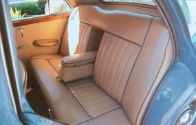 The high-grade appointments of the Magnette's four-place cabin featured leather upholstery, full floor carpeting, and a pull-down armrest for rear-seat occupants.