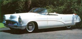 The restored 1953 Buick Wildcat I shows off its curvaceous form by playing off sun and shadow.