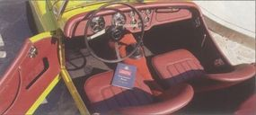 This TR2 featured blackberry leather upholstery and Olive Yellow paint.