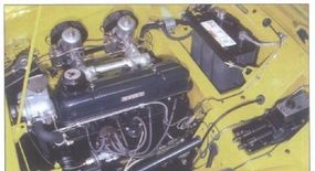 A Standard Vanguard 2.1-liter four was scaled back to 2.0 liters for the TR.