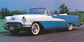 Oldsmobile gave its 1955 line a facelift that included a more rounded grille opening and splashier side trim and two-toning.