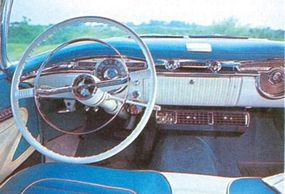 The Oldsmobile Starfire featured a lot of chrome on the dashboard.