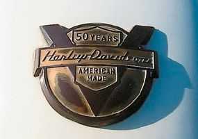 The 1954 50th Anniversary FLs wore special medallions on their front fenders.