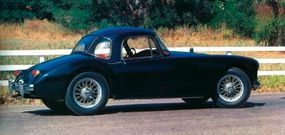 The 1957 MGA coupe weighed about 100 pounds more than the roadster.