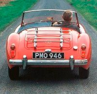 The spare tire nearly filled the trunk of the MGA, so many owners installed a luggage rack on the trunk.